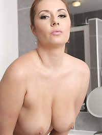 Sexy stunner Daria Glower puts on her makeup and takes off..
