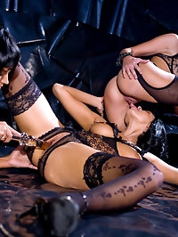 Three brunettes playing with their wet pussies using dildos