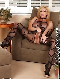 Naughty Rachel Aziani poses in her sexy crotchless..
