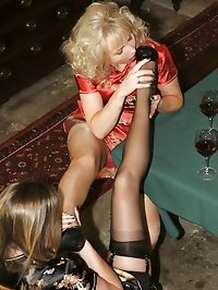 drunk girls bottle each other