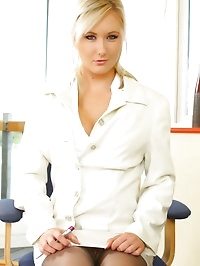 Sam in grey stockings and white business suit