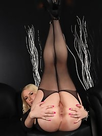 Blonde babe Vanessa posing in her black fishnets