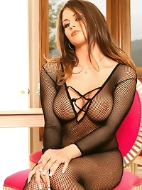 Nude in her fishnet suit