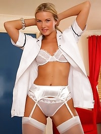 Hot nurse Vanesa in uniform masturbates in her stockings