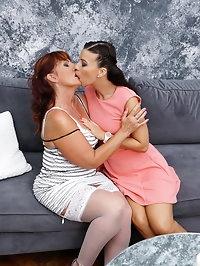 Horny mature lesbians go at it