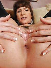 Sexy 47 year old Alexandra Silk tugging at her hot pussy..