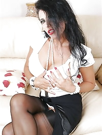Alluring darling strips on the couch