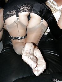 Sexy crossdresser in corset worshipping Nylon Jane