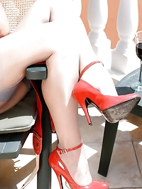 Astrid relaxes on the terrace in grey FFS nylons and red..