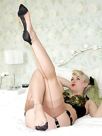 blonde pinup posing on bed in nylons