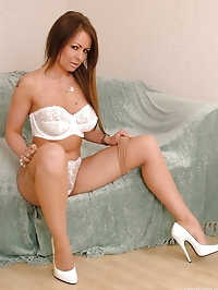 All white lingerie and gorgeous matching stilettos on this..