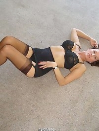 Busty Jane plays on the floor in stockings