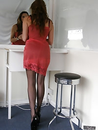 Hot red lingerie and long black nylons in this shoot