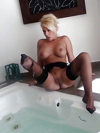 Leggy Lana gets her stockings wet and her mouth filled..