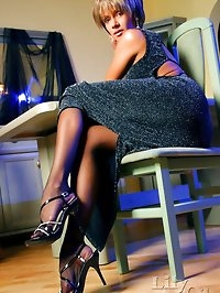 Charming leggy lady in vintage black stockings