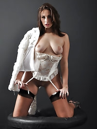 A sexy white corset covers this sexy babe and her gorgeous..