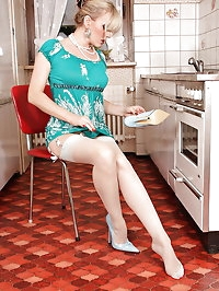 Housewife Alina in stockongs and high heels posing on the..