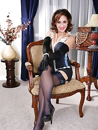 Stellat mature bitch sitting with her stockings on