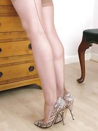 Busty blonde in snakeskin heels