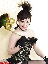 Heavenly brunette model in corset and black seamed..