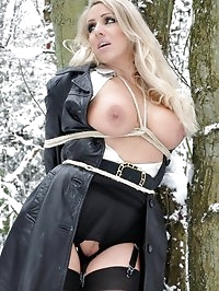 Plenty of outdoor fun in the snow with this tied up blonde..