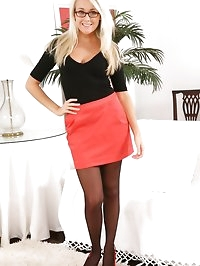 Lucy Anne wearing a tight black top with a red miniskirt.