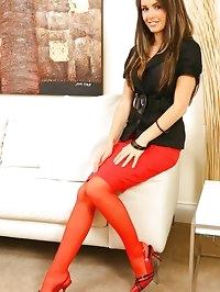 Long haired brunette looking cute in knee length skirt,..