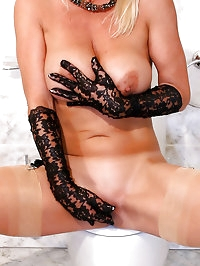 Sexy MILF Astrid in nude FFS stockings masturbates in the..