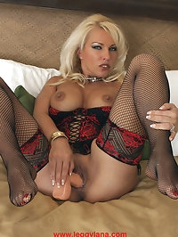 Leggy Lana wearing red and black lingerie and playing with..