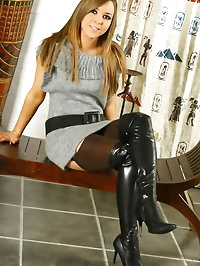 Luscious Loora in a sexy grey minidress, kinky black boots..