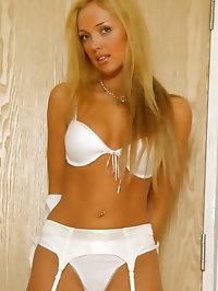 Gorgeous blonde in white mini skirt, stockings and white..