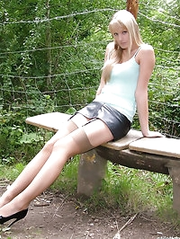 Stunning blonde Alexis outside in stockings and black..