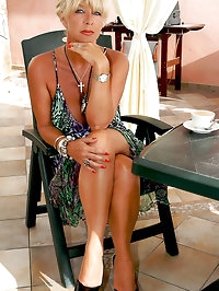 Busty MILF Astrid relaxes on the terrace in nude FFS nylon..