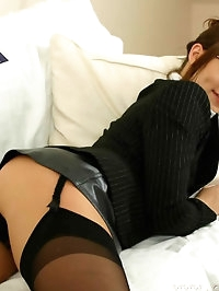Gorgeous babe in secretary outfit with stockings