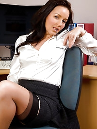 Brunette Marlyn gets sexy in her office and spreads open..