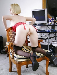Blonde office MILF strips and spreads her ivory legs