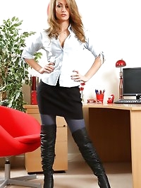 Naughty secretary removes all her clothes apart from..