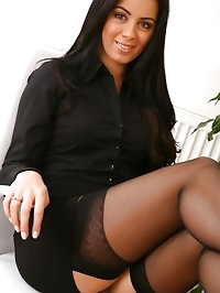 Natalia looking glorious in black miniskirt and top with..