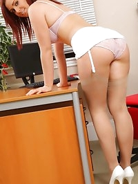 Kinky redhead teases her way out of her work clothes and..