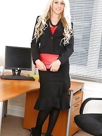 Abbi Taylor wearing secretary suit with black stockings..