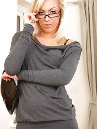 Beauty secretary looks stunning in minidress and stockings.