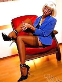 Horny leggy secretary in sexy brown stockings and stilettos