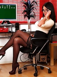 Secretary Lexi Lowe in stockings and high heels