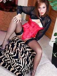 Magnificent mom in hot red corset and black stockings