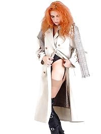 Sexy redhead Chiara slowly takes of her rain coat, to..