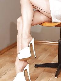 Blonde teacher Alina posing in stockings and high heels
