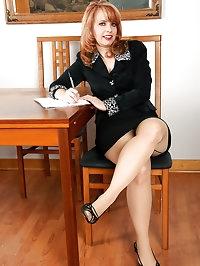 Redheaded office MILF Pandora Jones from AllOver30 getting..