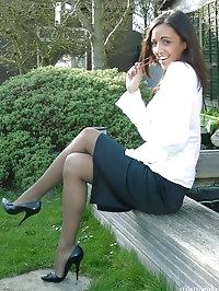Naughty secretaty strips outdoor in black stilettos