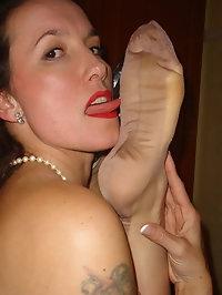 Nylon Jane licking gorgeous long legs on satin bed
