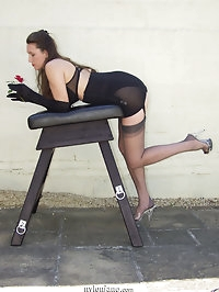 Jane and Saffy pose and bend over a bench